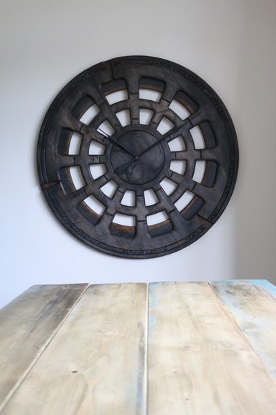 extra large clock above the wooden table