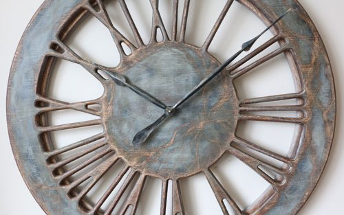 Skeleton Roman Numeral Wall Clock Close-Up showing Large Hand Carved Roman Numerals on transparent background.