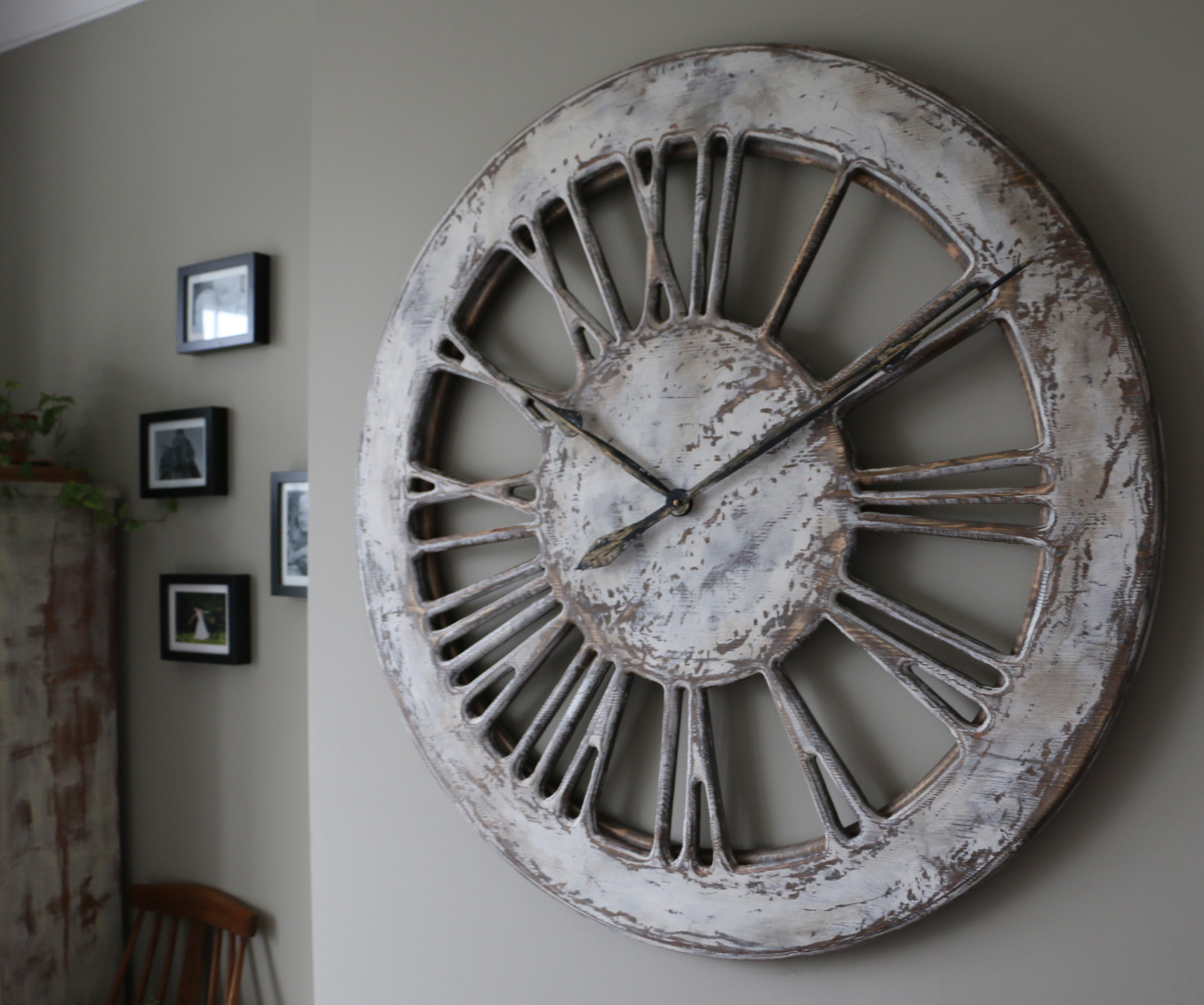 White Skeleton Wall Clock With Large Wooden Roman Numerals